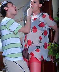 Nasty cross-dressing dude in hot red suspender tights takes up some manmeat