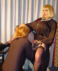 TGirl dressed up as a Nun on her knees sucking dick.