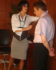 Sissy boy gets dressed up like a TGirl and spanked by his dominant female boss.