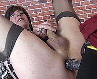 Strapon Jane gives horny TGirl Emily her big black strapon deep inside her ass hole