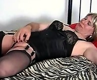 Strapon Jane bends over a slutty tranny and fucks her in the ass
