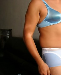 Cute pantie boy wearing a set of blue knickers with white suspenders