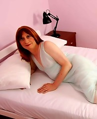 Sexy Lucimay posing on her large bed and ready to fuck